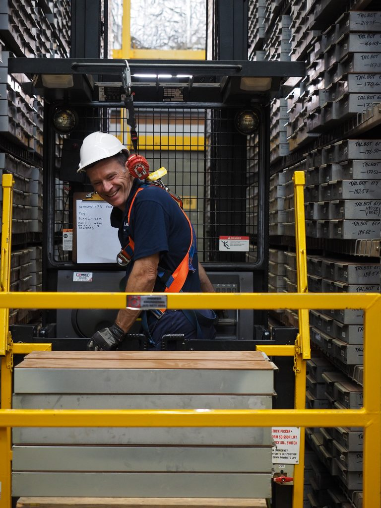 Senior Field Hand, Lex Klein, uses a high lift machine to retrieve boxes of geological core from the core library at the Exploration Data Centre (EDC).