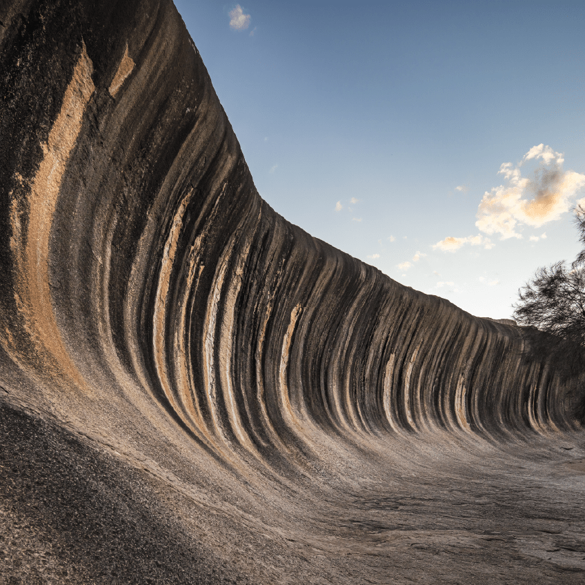 Wave Rock, a 15 metre high natural rock formation that is shaped like a tall breaking ocean wave and is located at Hyden in Western Australia